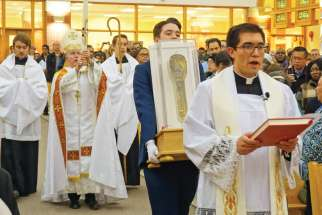 Some of the 80,000 people who came to see the relic hand and forearm of St. Francis Xavier on its cross-Canada tour, including stops at Calgary's St. Albert the Great Church, above, and St. Francis Xavier Parish inv, Ont., right.