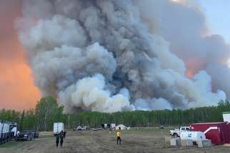 A forest fire is seen near High Level, Canada June 3, 2019. About 10,000 people in northern Alberta have been forced to evacuate since May 20 because of a series of spring wildfires.