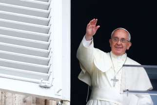 Pope Francis waves as he leads his July 13 Angelus prayer in St. Peter's Square at the Vatican.