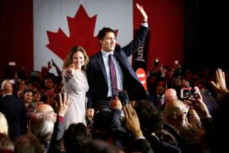 Liberal Party leader winner Justin Trudeau and his wife Sophie Gregoire wave during victory speech in Montreal, Oct. 19.