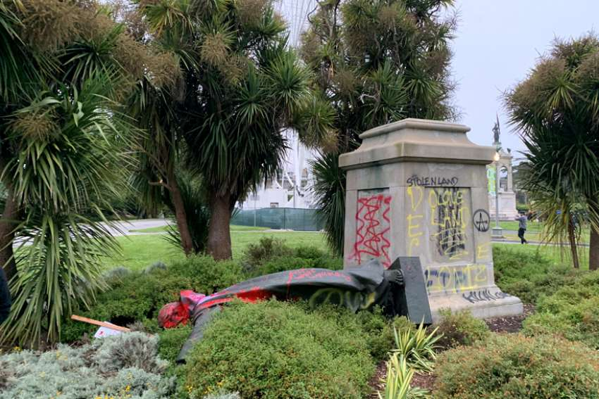 A vandalized statue of St. Junipero Serra in San Francisco is seen June 19, 2020. The Spanish Franciscan founded several missions in what is now California.
