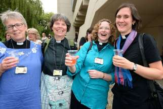 Women priests in in York, England, react after the General Synod of the Church of England voted July 14 to authorize the ordination of women as bishops. The decision overturns centuries of tradition in a church that has been deeply divided on the issue.