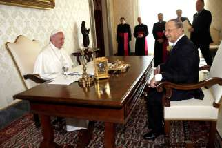 Pope Francis exchanges gifts with Lebanese President Michel Aoun during private meeting at the Vatican March 16.