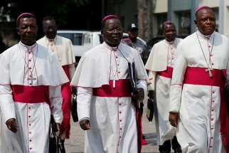 Congolese Bishop Fidele Nsielele Zi Mputu, Archbishop Marcel Utembi Tapa and Bishop Fridolin Ambongo Besungu arrive in December 2016 to mediate talks between the opposition and the government of President Joseph Kabila in Kinshasa.