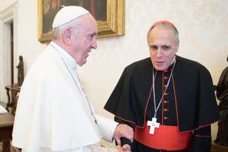 Pope Francis greets Cardinal Daniel N. DiNardo of Galveston-Houston, president of the U.S. Conference of Catholic Bishops, during a private meeting in 2017 at the Vatican. Pope Francis will meet Sept. 13 with Cardinal DiNardo and with Cardinal Sean P. O'Malley of Boston, president of the Pontifical Commission for the Protection of Minors, the Vatican press office announced Sept. 11.