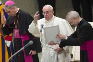 Pope Francis gestures during his Dec. 28 weekly audience in Paul VI hall at the Vatican.