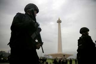 Armed policemen stand guard during a Dec. 21, 2017 ceremony ahead of the Christmas and New Year celebrations in Jakarta, Indonesia. Indonesia planned to deploy 250,000 security personnel across the country ahead of Christmas and New Year celebrations, particularly in Christian-majority areas.