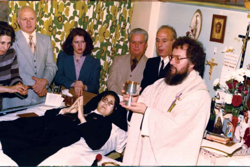 Fr. Claudio Piccinini celebrates Mass in 1977 in an all-purpose room in the Toronto hospital where Sr. Carmelina Tarantino professed her vows as the first Passionist Sister in Toronto.
