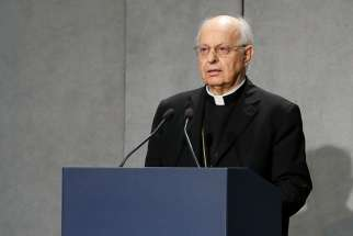 Cardinal Lorenzo Baldisseri, secretary-general of the Synod of Bishops, makes an announcement at the Holy See Press Office Oct. 2, 2019. Cardinal Baldisseri announced that Pope Francis has named Maltese Bishop Mario Grech as pro-secretary-general of the Synod of Bishops. He will eventually succeed Cardinal Baldisseri as secretary-general of the synod.