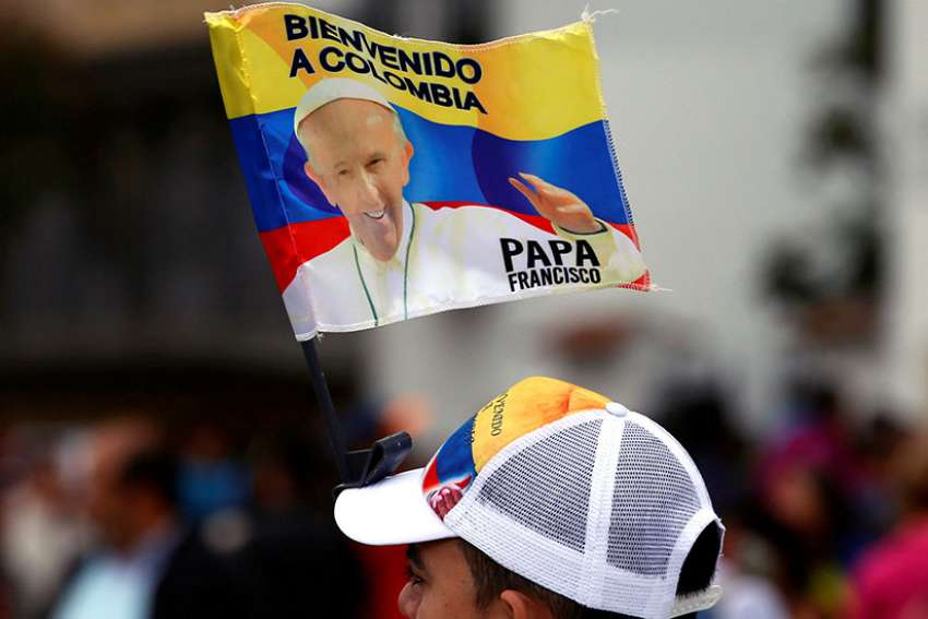 A man is seen with a Pope Francis flag in Bogota, Colombia, Sept. 3.