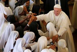 Pope Francis greets nuns after attending the recitation of midday prayer in the Discalced Carmelite Monastery in Antananarivo, Madagascar, Sept. 7, 2019.