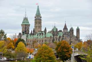 Flags fly at half-mast on the Canadian Parliament buildings in Ottawa, Ontario, Oct. 23. Cpl. Nathan Cirillo, a Canadian soldier, was shot and killed while on duty at the nearby National War Memorial.