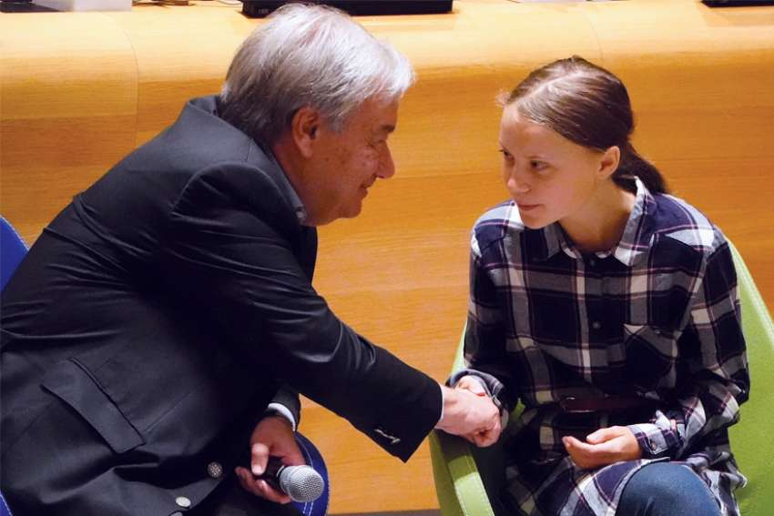 UN Secretary-General Antonio Guterres greets 16-year-old Swedish climate activist Greta Thunberg Sept. 21 during the Youth Climate Summit at UN headquarters in New York City.