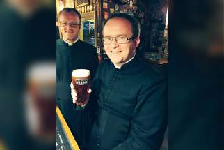 Seminarians of the Cardiff archdiocese enjoying a pint at The City Arms in Cardiff, Wales.
