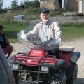Fr. Bart Burke drives an ATV to visit his four missions in Sandy Lake, Northern Ontario, in the archdiocese of Keewatin-Le Pas. Annuities with Catholic Missions In Canada can help fund the work.