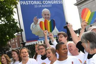 An LGBT choir sings outside the Pastoral Congress at the World Meeting of Families in Dublin Aug. 23.
