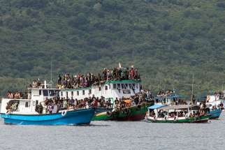 Catholic faithful stand on wooden boats during the sea procession of Good Friday in Larantuka, Indonesia, in this April 18, 2014, file photo.