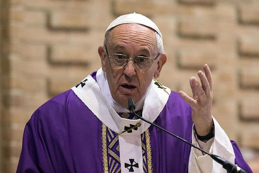 Pope Francis gestures as he celebrates Mass March 12 at the Rome parish of St. Magdalene of Canossa.