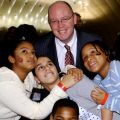 Kevin Ryan, president of Covenant House, is pictured with Covenant House children at left in this undated photo. His book Almost Home is climbing bestseller charts in Canada and the United States.