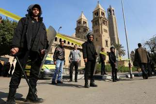 Members of the special police forces stand guard to secure the area around the Coptic Orthodox cathedral complex Dec. 11, 2016 after an explosion inside the complex in Cairo.
