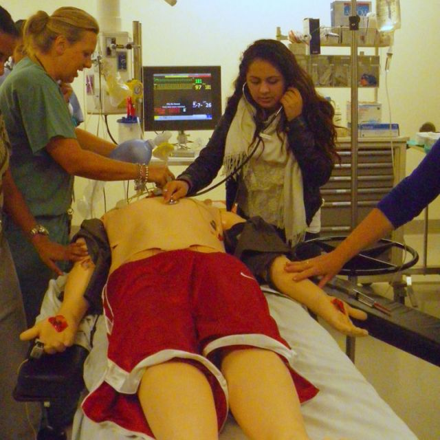 Julie Mauceri (left) leads high school students in a mock trauma resuscitation in the Allan Waters Family Simulation Centre.