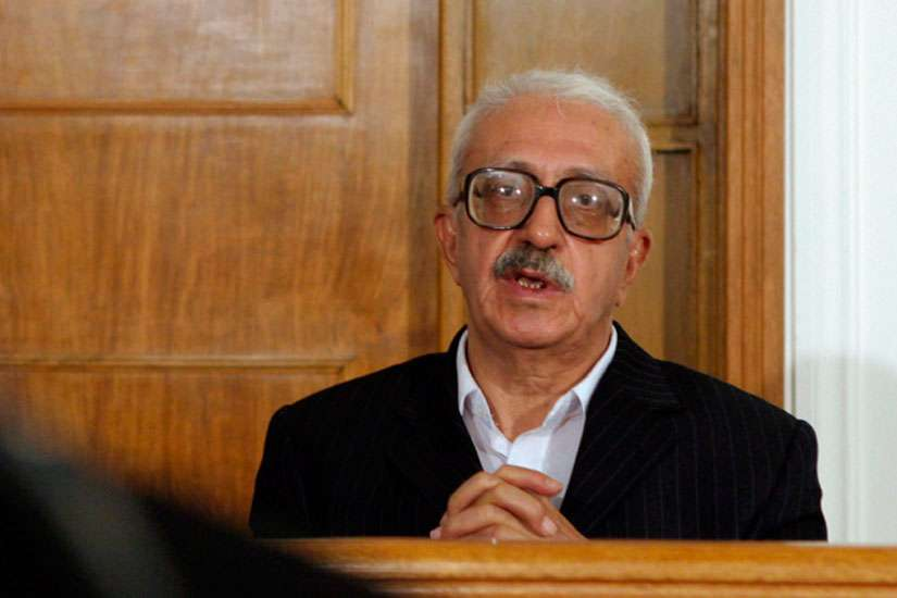 Iraq's former Deputy Prime Minister Tariq Aziz appears before an Iraqi tribunal in Baghdad in 2004. Aziz, 79, died of a heart attack June 5.
