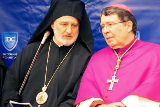 Archbishop Elpidophoros of the Greek Orthodox Archdiocese of American and Archbishop Christophe Pierre, apostolic nuncio to the United States, are seen at the In Defense of Christians Ecumenical Prayer Service July 15, 2019, in Washington. The prayer service opened the second annual Ministerial to Advance Religious Freedom, taking place July 16-18, 2019, and convening government officials, representatives of international organizations, faith leaders, rights advocates and members of civil society organizations from around the world to discuss challenges to religious freedom.