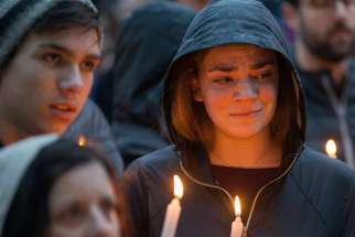 People mourn during a candlelight vigil Oct. 27, 2018, for victims of the shooting that killed eleven people at the Tree of Life Synagogue in Pittsburgh. In light of continued attacks on houses of worship and holy sites around the world, the U.S. Commission on International Religious Freedom held an Oct. 23, 2019, hearing at the Capitol to learn ways to deter such attacks.