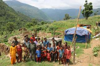 Catholic families stand in front of home on Kyaltung Mountain in Sindhupalchowk, Nepal, July 12.