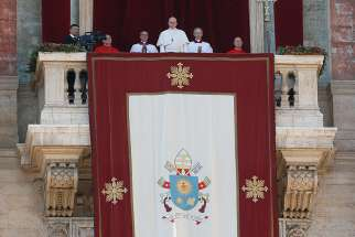 "Pope Francis delivers his Christmas message and blessing ""urbi et orbi"" (to the city and the world) from the central balcony of St. Peter's Basilica at the Vatican Dec. 25."