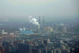 A thermal power plant is seen Nov. 21 near residential buildings in Beijing. As government delegations from across the globe prepare for a Dec. 2-14 U.N. conference on climate change, Catholic organizations are urging radical steps and pledging to make the church's voice heard.