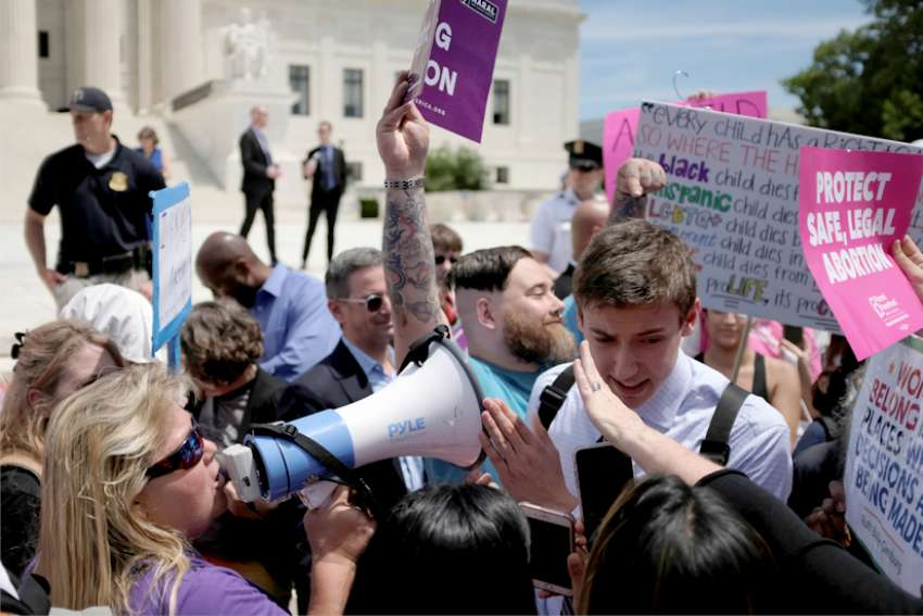 Pro-life protesters demonstrate during a protest of supporters of abortion outside the U.S. Supreme Court in Washington May 21, 2019.