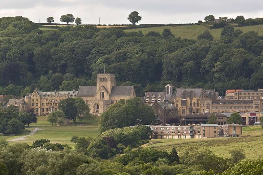 View across the valley of the monastery and college buildings of Ampleforth, a Benedictine abbey and college in north Yorkshire, England.