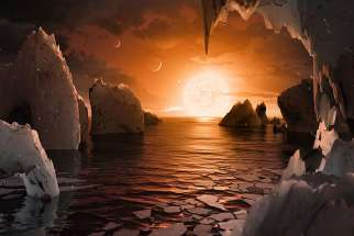 An artist's depiction shows the possible surface of TRAPPIST-1f, on one of seven newly discovered planets in the TRAPPIST-1 system.