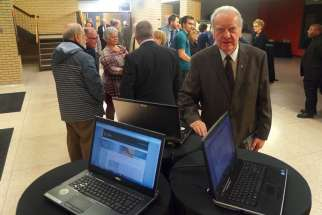 Fr. Pierre Hurtubise, OMI, with laptops showing the new Internet portal to inventories of tens of thousands of Vatican documents on Canada from 1622-1922. The Saint Paul University professor has been part of an international team that began the archive project in 1977. The website was launched Nov. 3.