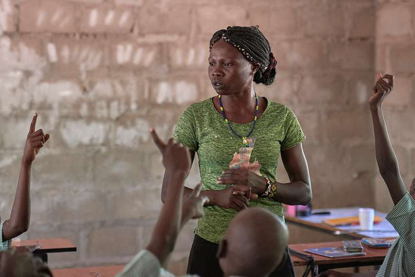 Masidalia Abduraman teaches a class April 30 in the Catholic school in Kauda, a village in the Nuba Mountains of Sudan. The area is controlled by the Sudan People's Liberation Movement-North, and frequently attacked by the military of Sudan. Catholic Church workers have accompanied people in the region, experiencing the same challenges as the people they serve.