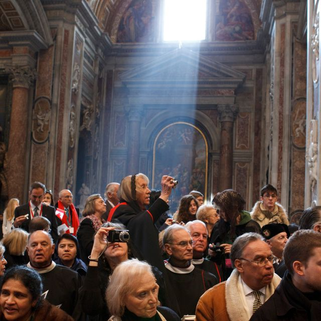 Sunlight streams onto pilgrims in St. Peter's Basilica after a consistory led by Pope Benedict XVI at the Vatican Feb. 18. The pope created 22 new cardinals from 13 countries -- including two from the United States and one from Canada.