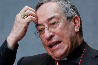 "Cardinal Oscar Rodriguez Maradiaga of Tegucigalpa speaks during a press conference at the Vatican May 12, 2015. In their July 30 statement, the Honduran bishops lamented that these news reports may have ""disturbed"" the People of God."