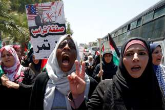 "Demonstrators take part in a rally in Gaza City July 1, 2020, as Palestinians called for a ""day of rage"" to protest Israel's plan to annex parts of the Israeli-occupied West Bank."