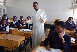 Ayub Mohamud, center, teaches a religious education class at Eastleigh High School in Nairobi, Kenya, on March 2, 2016. Mohamud is the Muslim spiritual affairs patron, but Eastleigh High does not employ a chaplain.