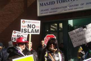 More than a dozen anti-Muslim protesters gathered outside a downtown Toronto mosque Feb. 17.