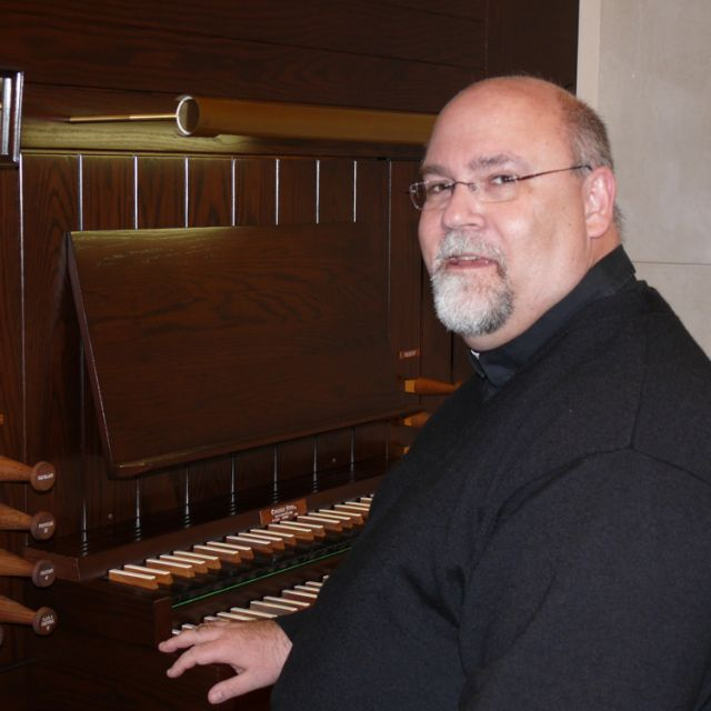 Fr. Shayne Craig sits next to the 30-year-old Casavant pipe organ installed in the chapel of Edmonton's St. Joseph's Seminary in January.
