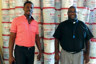 Caritas co-ordinators with hygiene kits for hurricane victims in Haiti.