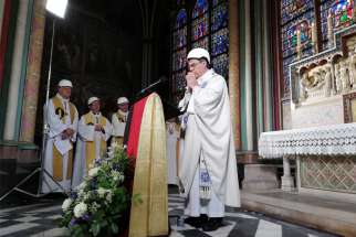 Archbishop Michel Aupetit of Paris celebrates Mass in the Chapel of the Virgin inside Notre Dame Cathedral June 15, 2019. It was the first Mass since a huge blaze devastated the landmark building in April.