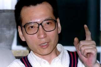 Liu Xiaobo, the 2010 Nobel Peace Prize winner, who was recently released from a prison in China's northeast, died July 13 at age 61. He is pictured in an 1995 photo.