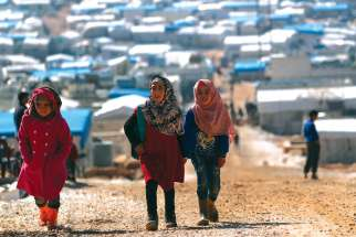 Internally displaced Syrian children walk together at a camp near the Turkish border in Atmeh, Syria. Syrian refugees have been the greatest recipient of Canada's refugee program in the last five years, with two-thirds ending up in the privately-sponsored refugee program.
