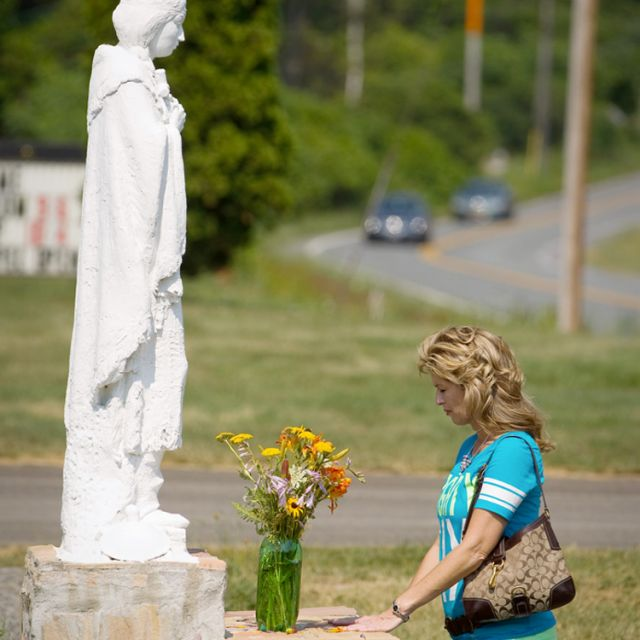 Michelle Sherlock of August, Ga., prays in front of a statue of Blessed Kateri Tekakwitha on her July 14 feast day in Fonda, N.Y. Blessed Kateri will become the first member of a North American tribe to be declared a saint when she is canonized Oct. 21. The Fonda shrine dedicated to her is located near the 17th-century Mohawk settlement where she was raised and baptised.