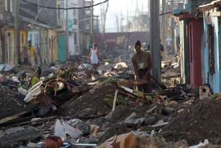 People search for belongings Oct. 7 in the devastation caused by Hurricane Matthew in Baracoa, Cuba. The powerful hurricane left serious damage at the eastern end of the island, with landslides, toppling electricity poles and cutting off roads by flooding.