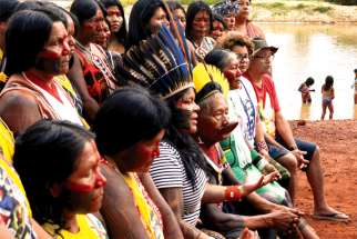 Indigenous people are seen on the banks of the Xingu River in Brazil's Xingu Indigenous Park. Canada and the Amazon region both face issues over their Indigenous populations.