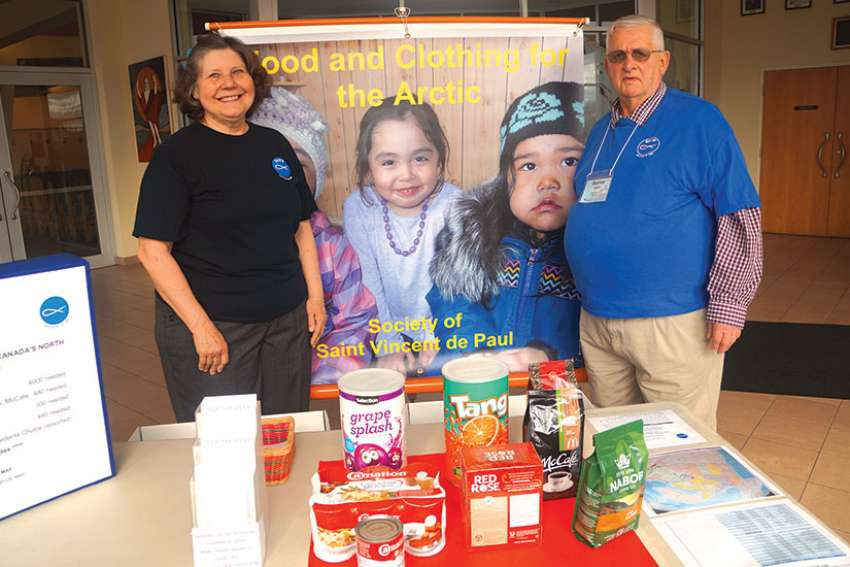 Wanda and Bernie Hartlin with the North of 60 display at Holy Redeemer parish in Ottawa showing the items needed to fill the sea container.